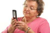 Bigstockphoto_Senior_Woman_Using_Cell_Phone_2930471