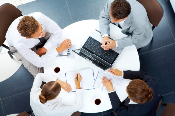 Above view of several business people planning work at round tab